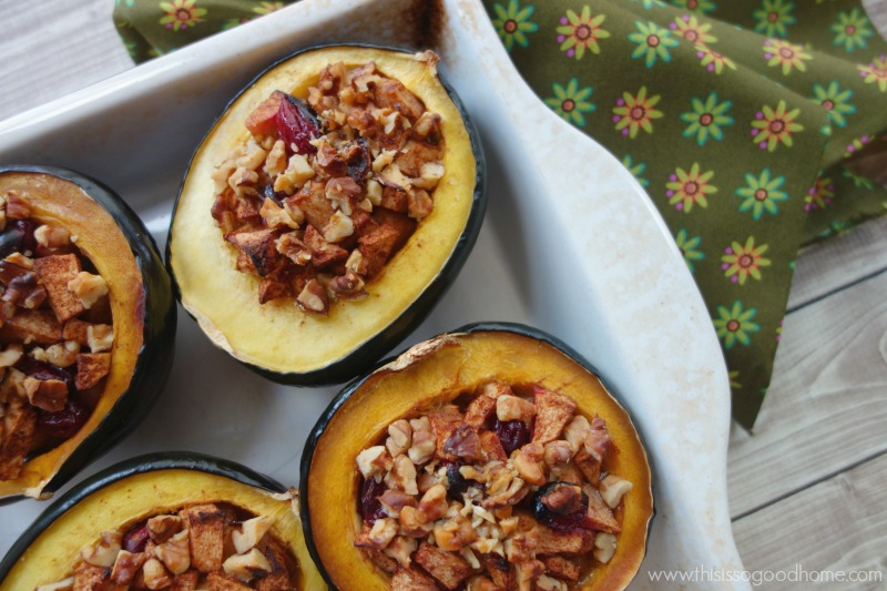 Baked Squash with Buttered and Spiced Fall Fruit is elegant enough for a dinner party or your Thanksgiving table but is simple enough to make for a weeknight meal. Buttery acorn squash is stuffed with apples, pears, and cranberries, baked in butter, and topped with crunchy nuts! // deliciousobsessions.com
